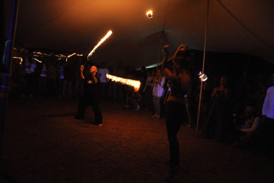 Dingo and Molly slinging fire at Bubble Festival