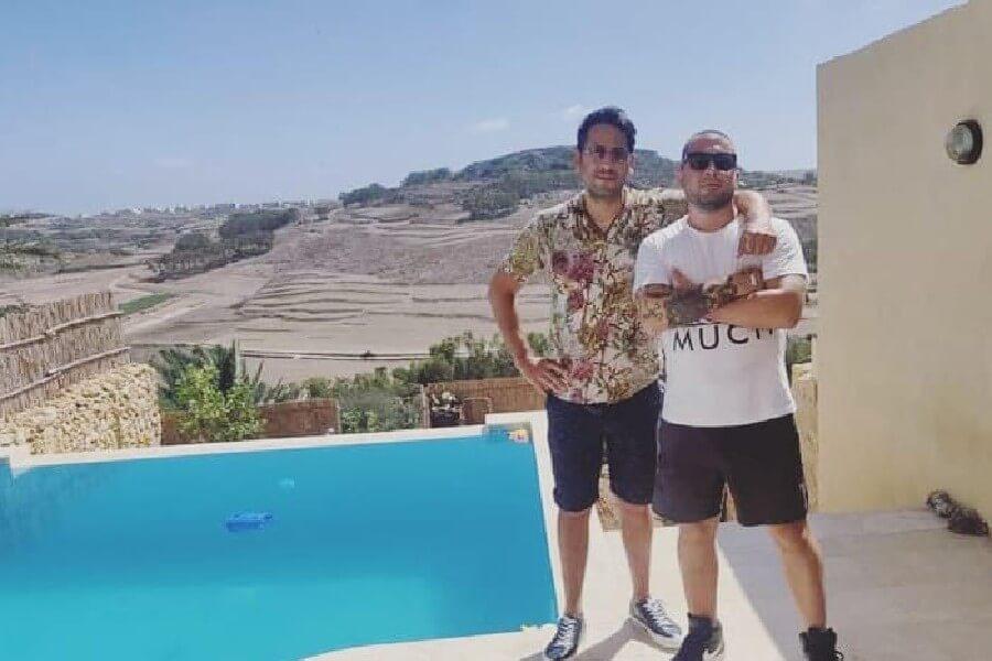 Rikki alongside hip hop artist Digby at the studios pool